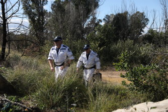 Police investigate the area in which a woman's body was found in Sydney's south on Thursday.