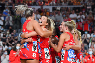 Swifts players enjoy the moment after their grand final victory.