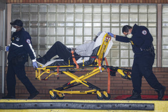 Paramedics wheel a patient into the emergency room at Wyckoff Heights Medical Centre in New York.