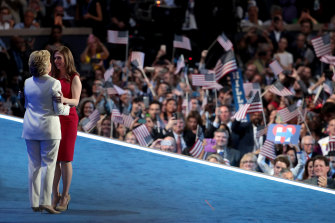 2016 Democratic presidential nominee Hillary Clinton embraces her daughter Chelsea after being introduced on the fourth day of the Democratic National Convention in Philadelphia, Pennsylvania.