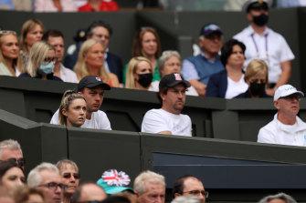 Garry Kissick (centre) watches the Wimbledon final.