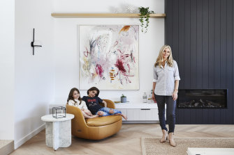 Amanda with Willa and Freddie in the family lounge. The artwork is by Michelle Breton from Thierry B Fine Art.