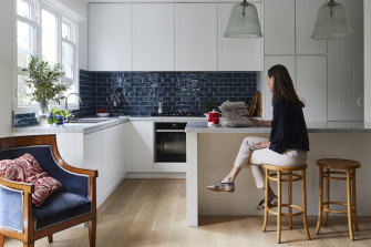 Anna at the kitchen bench, by Bloom Interior Design, while the cabinetry was designed by LNP Schade Cabinets.