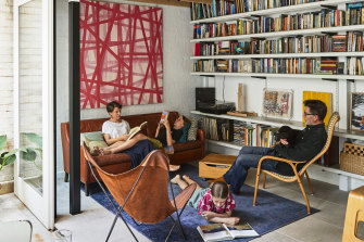 """The living room may be small, but Ruth is more than happy with it. """"The reality is that that's all you need,"""" she says. The large pink artwork is by Brett McMahon."""