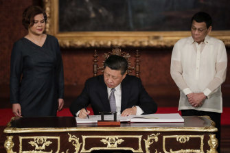 Daughter Sarah Duterte, seen here on left with Chinese President Xi Jinping and her father President Rodirgo Duterte at the Malacanang Palace in 2019, has been talked about as a possible successor.