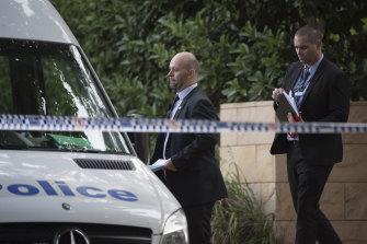 Police establish a crime scene at the unit on Bobbin Head Road, Pymble, where the woman's body was found.