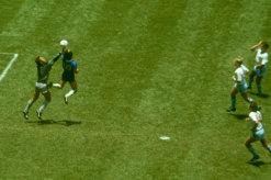 Maradona outjumps England goalkeeper Peter Shilton to score his 'Hand of God' goal.