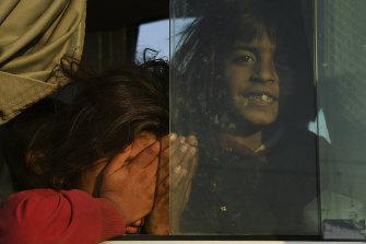 Syrian refugees are taken on buses to Bardarash refugee camp in Iraqi Kurdistan.