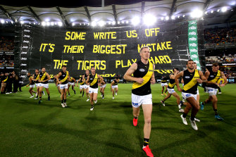 Jack Riewoldt leads the Tigers out.