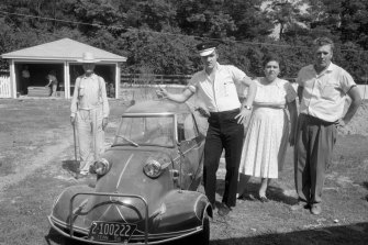 Elvis with parents Vernon, and Gladys in the backyard of the house at 1034 Audubon Drive, Memphis, Tennessee  with the Messerschmitt.
