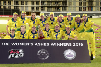 Ashes winners: Australia celebrate after retaining the urn.