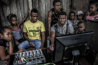 Young people at a computer during a weekly market in the Sava region of Madagascar, May 2018. Madagascar has little obvious strategic value for the Kremlin or the global balance of power.