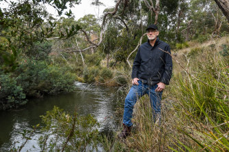 Cameron Steele by the Moorabool River near Meredith. He is calling for a reduction in water extraction from the river.