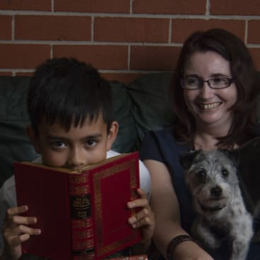 Julie Peno and her son Declan read together at home.