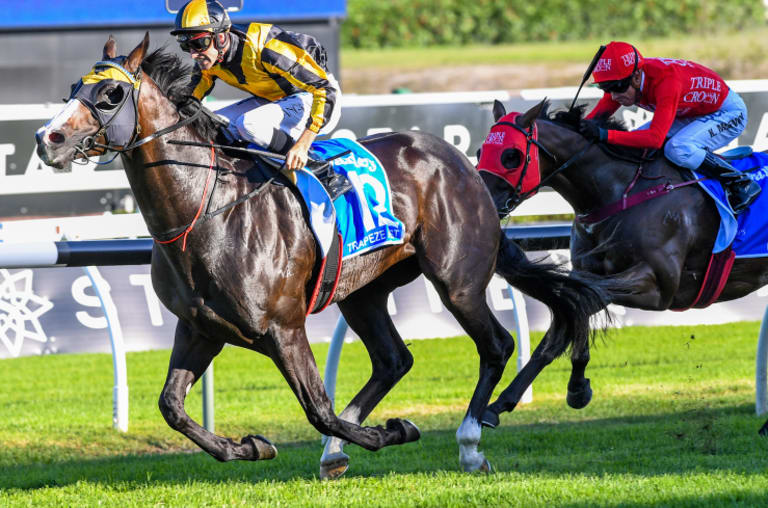 Peaking: Trapeze Artist races away from Redzel in the TJ Smith.
