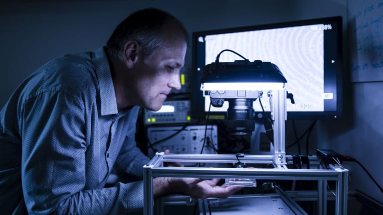 Neurophysiologist Dr Ingvars Birznieks uses high tech devices to investigate sense of touch in fingertips in his lab at Neuroscience Research Australia.