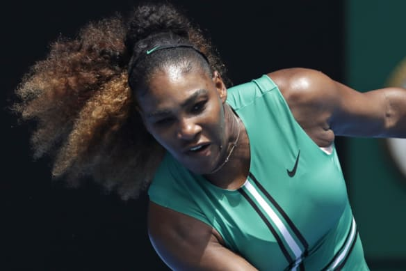 Serena Williams hits a forehand return to Germany's Tatjana Maria during their first round match at the Australian Open tennis championships in Melbourne, Australia, Tuesday, January 15, 2019