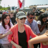 Democratic presidential candidate Senator Elizabeth Warren is swarmed by the media while walking past the Homestead Detention Centre, where the US is detaining migrant teens, in Homestead, Florida.