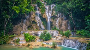 The sculptural cascades of Kuang Si Falls.