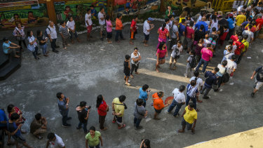 Voters wait in line to cast their ballots at a polling station during the mid-term election.