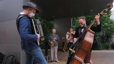 Dave Evans, Vincent Murphy, Ros Jones  and Dan Witton playing outside Mercy Place in Parkville.