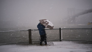 Snow falls at Brooklyn Bridge Park.