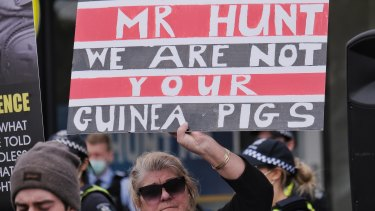 An anti-vaccination protest at Health Minister Greg Hunt's office on Saturday.