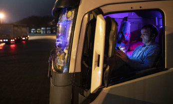 A Romanian lorry driver waits in his cab at Ashford lorry park as restrictions on travelling to the continent continue.