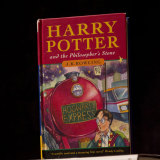 A first edition copy of Harry Potter and the Philosopher's Stone.