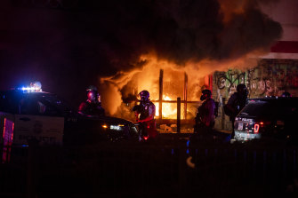 A fire burns inside of an Auto Zone store near the Third Police Precinct on May 27, 2020 in Minneapolis.