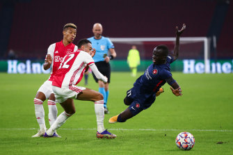 Awer Mabil of FC Midtjylland is fouled by Noussair Mazraoui of Ajax.