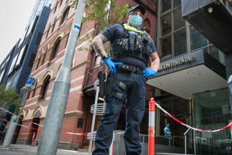 A police officer outside a quarantine hotel in Melbourne in April.