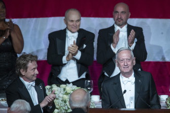 Former US secretary of defence Jim Mattis, right foreground, receives a standing ovation during the 74th Annual Alfred E. Smith Memorial Foundation Dinner.