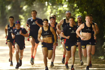 Christian Petracca and Clayton Oliver lead the Demons in a November training session.
