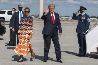 Melania Trump emerged from Air Force One in a Gucci dress, a bright contrast to her all-black departure ensemble.