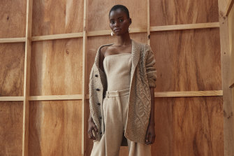 "R.M. Williams cardigan, $199. Jacinta James bustier, $1100, and pants, $1100. Reliquia ""Cocoon"" pearl earrings, $199 (worn throughout). Christian Dior loafers, $1390."