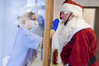 A German Santa takes a coronavirus swab test in Schwerin, Germany.