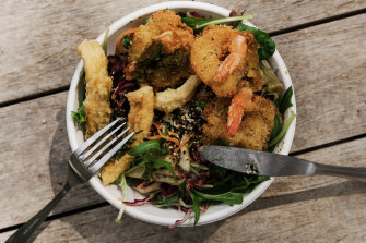 Greg Mullins ate take away salt and pepper squid and coconut prawn salad  from Seachange Cafe in Dee Why.
