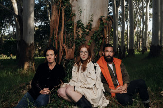New works were created by artists (from left) Yasmin Smith, Anna May Kirk and Dean Cross, pictured here at the base of a eucalyptus tree in Centennial Parklands.