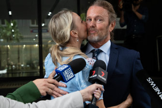 Craig McLachlan is kissed by his partner, Vanessa Scammell, after the verdicts.