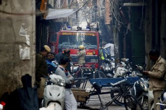 A fire truck attends the site of a deadly fire in New Delhi on Sunday.