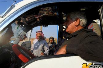 Taha Okan, 73, and his wife Aisha, 67, climb into a van destined for Hasakah.