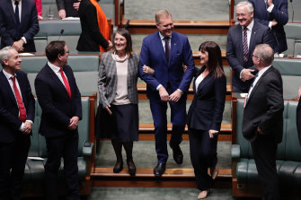 "Tony Smith is ""dragged"" to the speaker's chair by Labor's Maria Vamvakinou and Liberal MP Lucy Wicks."
