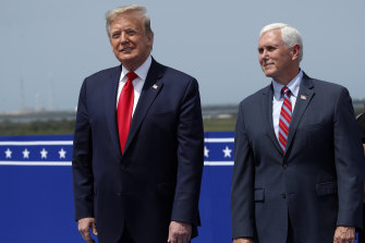 President Donald Trump stands with Vice-President Mike Pence as they wait to view the SpaceX flight to the International Space Station.