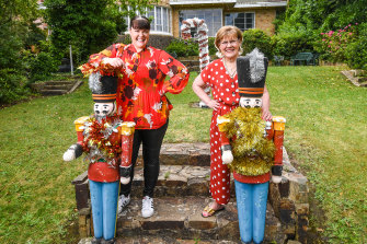 Longtime Ivanhoe resident Jennifer Bell, right, with daughter Louise and festive friends, is disappointed The Boulevard Christmas lights have been called off this year.
