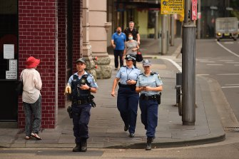 NSW Police patrolling near the Sydney CBD soon after the public health orders took effect.