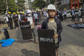 Anti-coup protesters with makeshift shields during a rally in Yangon, Myanmar on Wednesday.