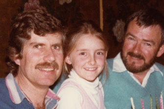 "Katie Little with her two ""uncles"", Colin Brees, left, and Colin Johnston."