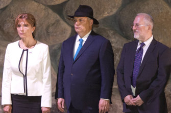 Hungarian Prime Minister Viktor Orban centre, his wife Aniko Levai and Director of the Yad Vashem Libraries Dr Robert Rozett attend a memorial ceremony at the Yad Vashem Holocaust Memorial in Jerusalem.