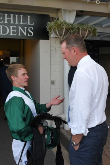 Job well done: Brock Ryan talks to trainer Michael Hawkes in the mounting yard.
